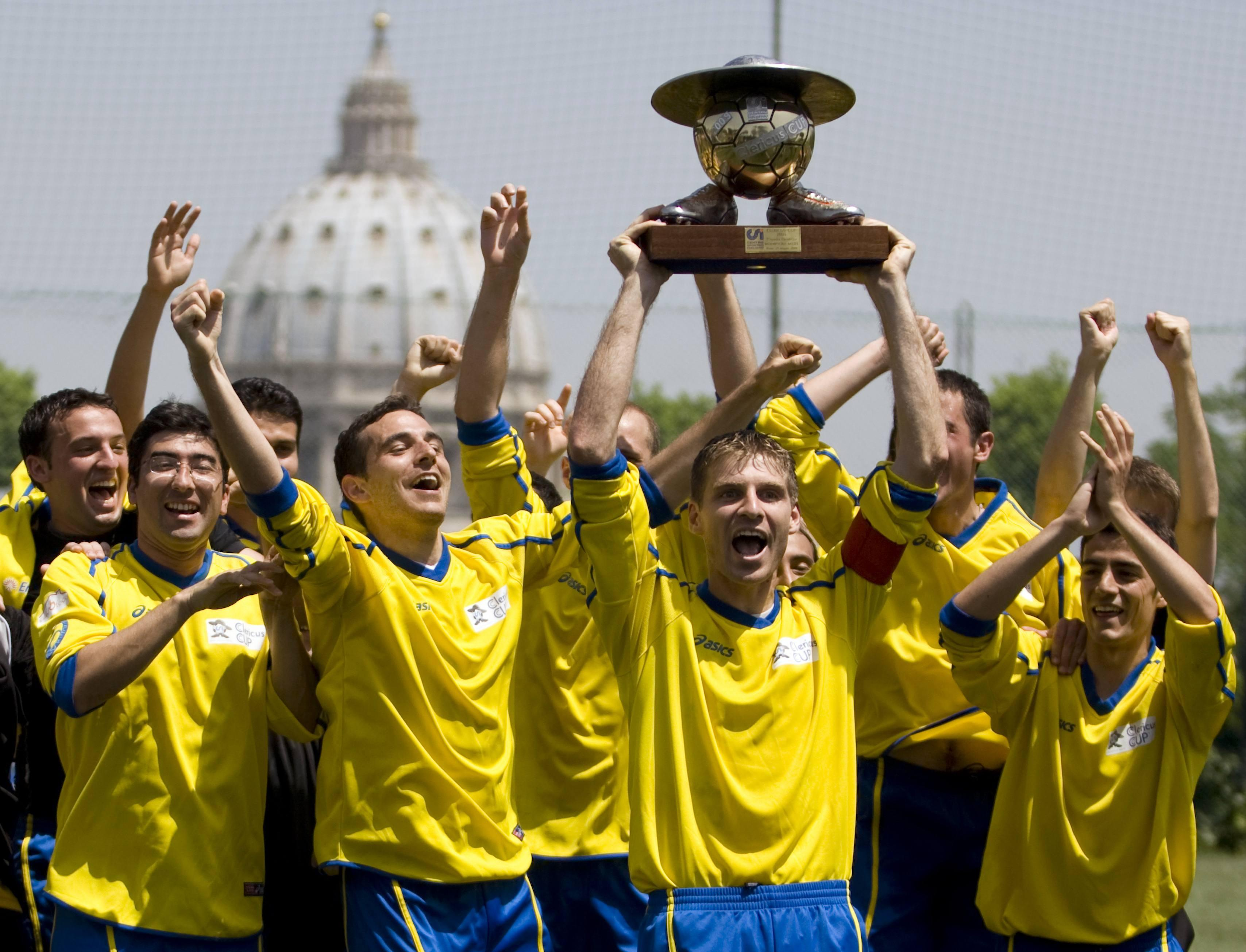 Players from the international soccer team of priestly scholars Redemptoris Mater celebrate after winning the Clericus Cup in Rome